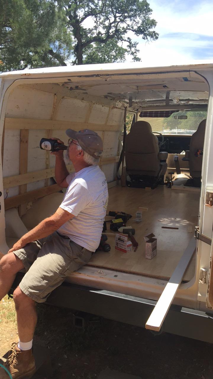 drinking beer in camper van